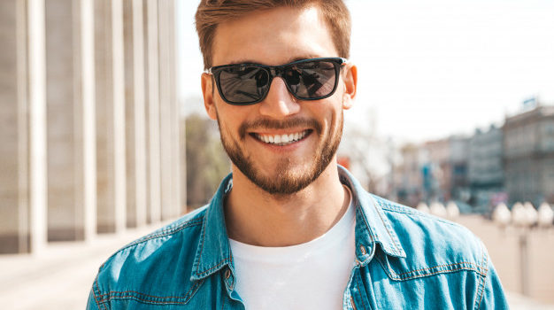 portrait-handsome-smiling-stylish-hipster-lumbersexual-businessman-model-man-dressed-jeans-jacket-clothes